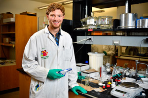 NSF-REU chemistry student Will Rackers in a chemistry lab
